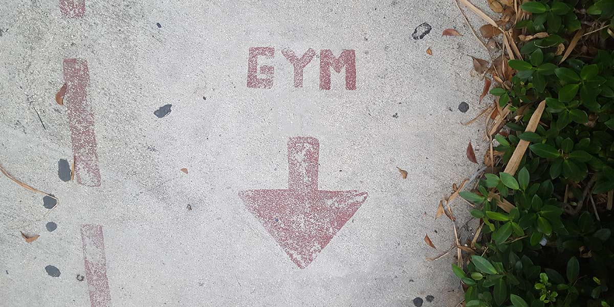 Gym sign on pavement