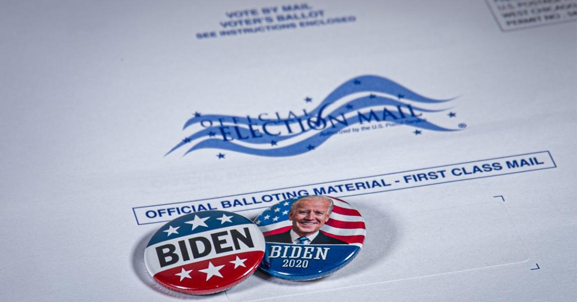Joe Biden badges on the election mail envelope
