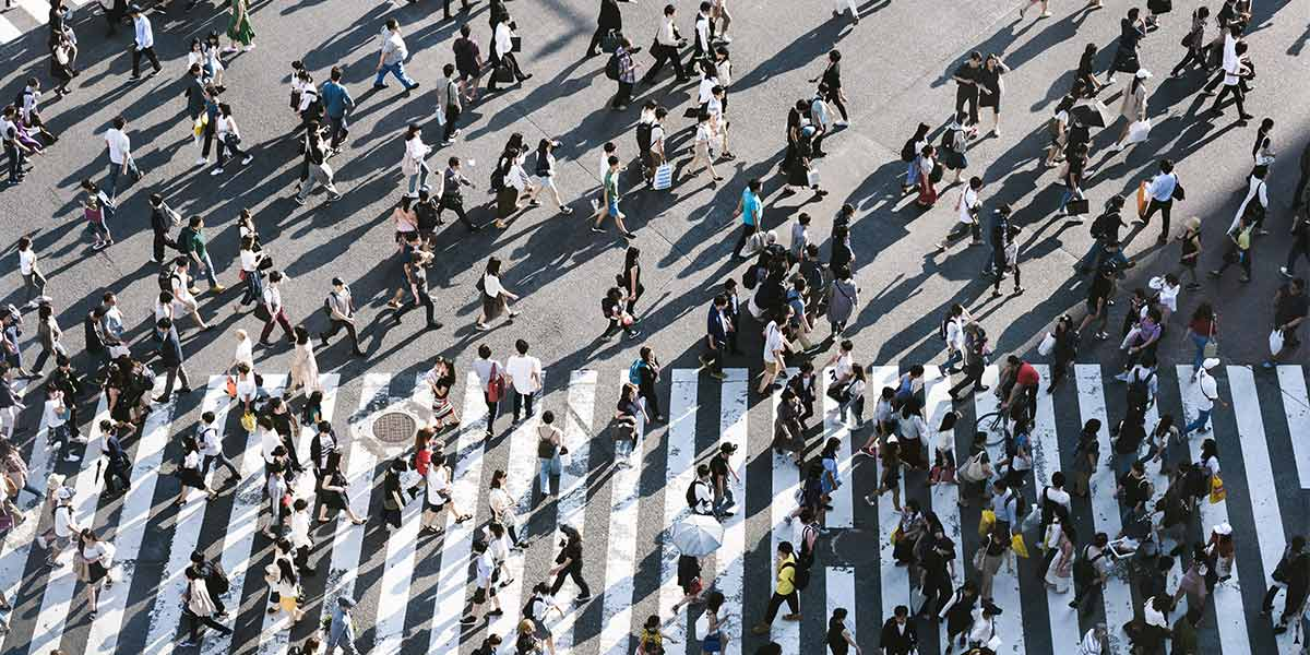 Crowd crossing the road