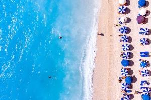 Beach with umbrellas from above