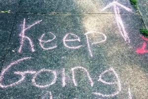 Keep going writing on a pavement