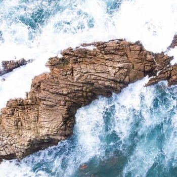 Waves against a rock